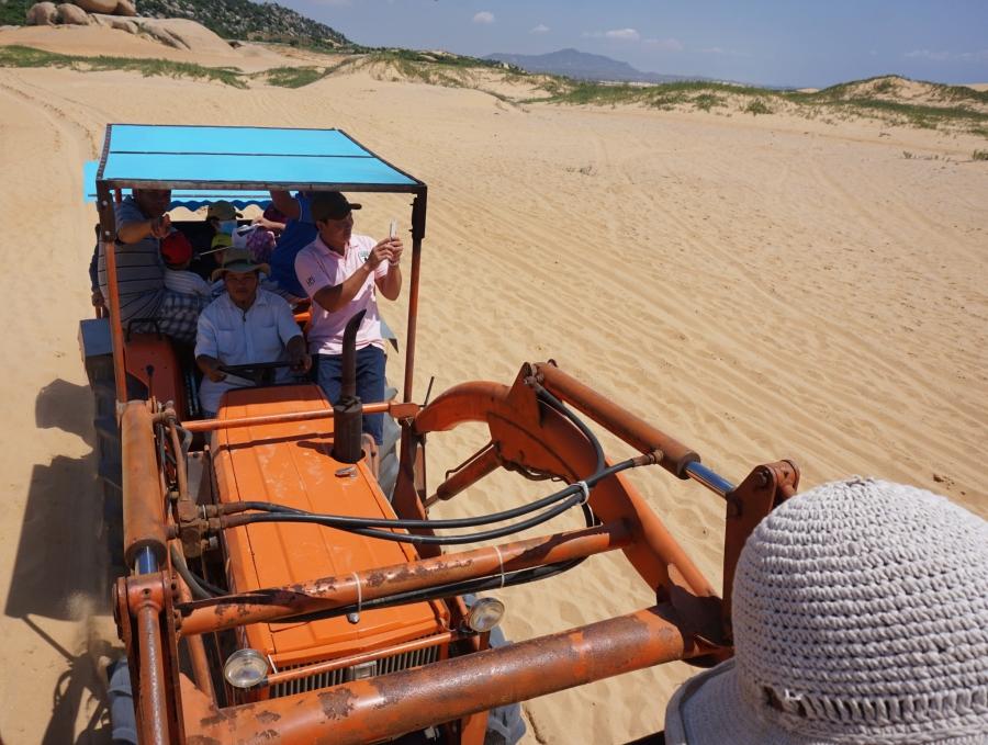 Riding in the tractor shovel, paradise, beach, local transportation, Vietnam