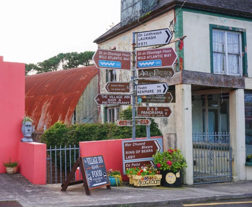 Wild Atlantic Way signs in the town of Ardgroom, Beara Peninsula.