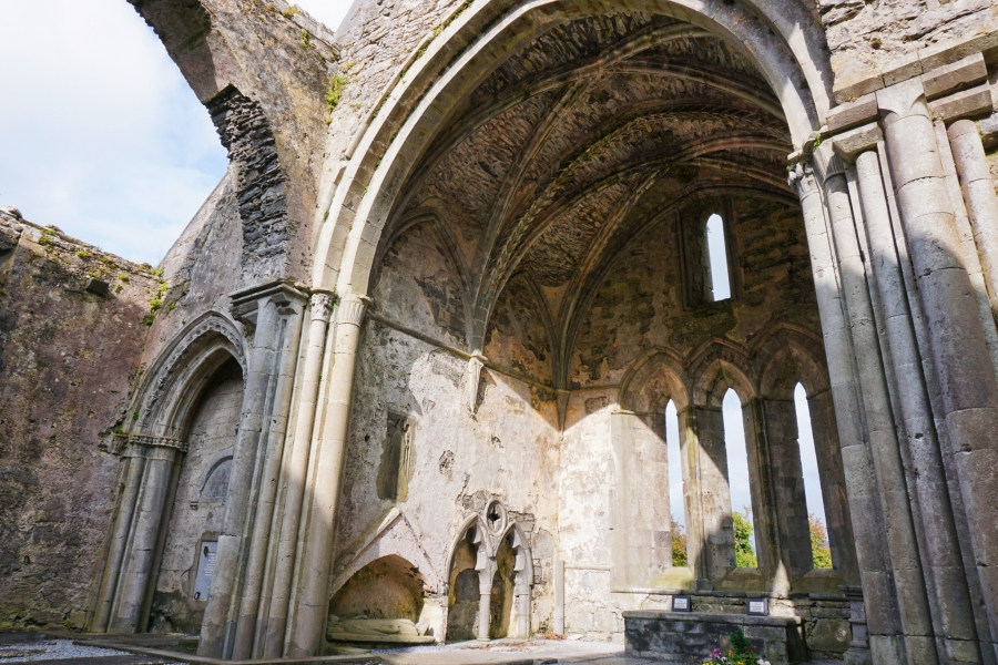 Corcomroe Abbey architecture has lots of arches and stonework.