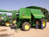 It's a family effort to get the combine ready for harvest.