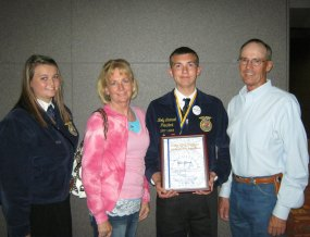 Our son, Kody, receiving his State Farmer Degree at the FFA Convention.