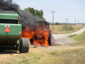 The Fishers' neighbor's tractor on fire.