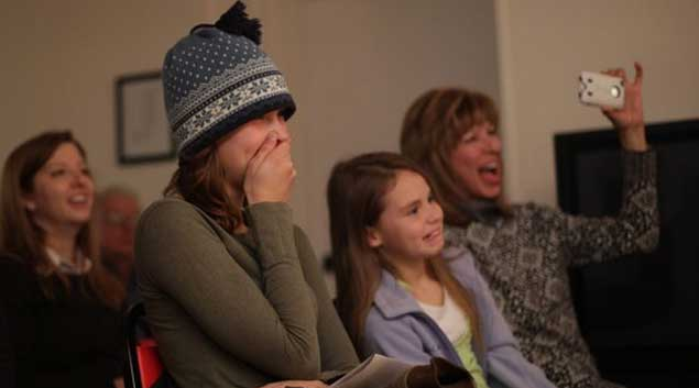 Haley Cassell, 16, laughs with her sister, Olivia, 8 (center), and her grandmother Anita (right) as Haley's mother, Amy, performs in A Center Point Holiday at the facility in north Tulsa. The holiday play was written, organized and performed by the 33 women in the program for their families and friends. Center Point in Tulsa provides therapeutic recovery for incarcerated women with drug and alcohol addictions.