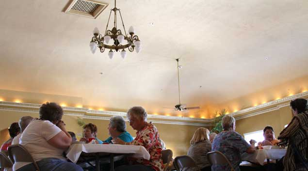 Residents of The Aldridge Hotel in Shawnee enjoy a potluck dinner Thursday. The hotel is one of the many historic sites in Oklahoma that has been renovated with help from Oklahoma's historic preservation tax credit. The hotel, placed on the National Register of Historic Places in 2000, is now a 60-unit apartment complex for low-income seniors.