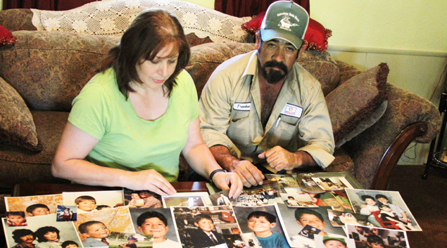 Connie and Frankie Marquez display family photos documenting their years in Hennessey.