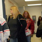 Patients wait their turn in the clinic hallway.