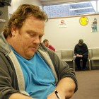 David Haese fills out clinic paperwork.