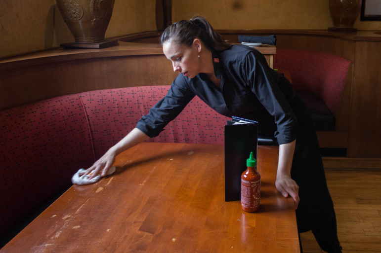 Sommer Lyons, a teacher at ECDC Public School in Tulsa, works a second job at Te Kei's restaurant to help make ends meet.
