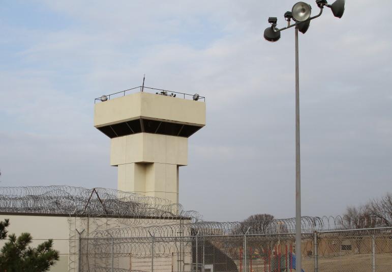 Razor-wire fencing surrounds the Joseph Harp Correctional Center in Lexington.