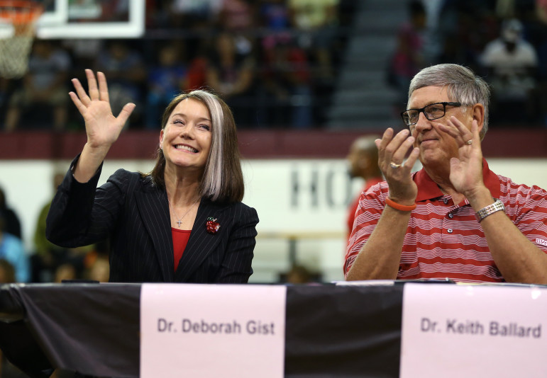Tulsa Public Schools Superintendent Deborah Gist (left) is introduced with previous superintendent Keith Ballard (right) during a back-to-school event at McLane High School in Tulsa on Aug. 28, 2015.