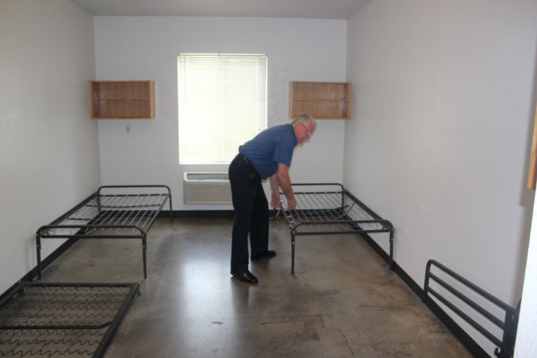 Tom Jones, who oversees City Rescue Mission in downtown Oklahoma City, arranges beds in a new 150-bed wing that serves as a night shelter for homeless youths ages 15 to 17. However, few youths have taken advantage of the shelter.