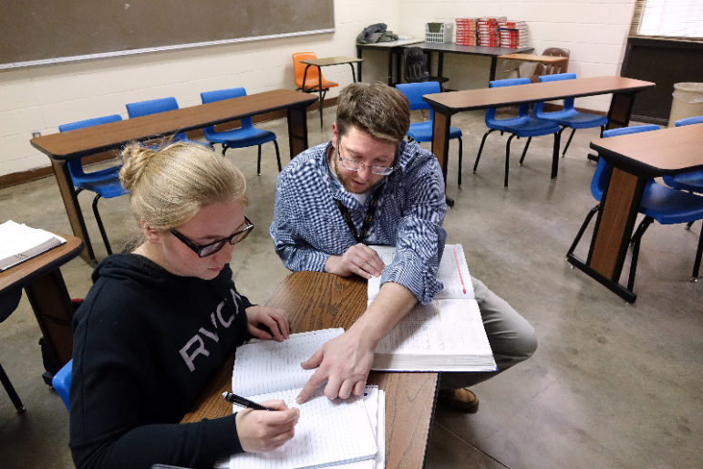 Senior Alexa Ostmeyer, 18, gets help with a math problem from AP calculus teacher Jimmy Hartford during class.
