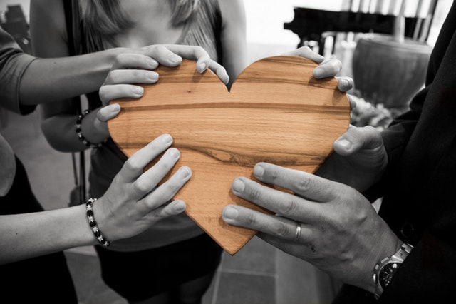 hands holding a heart - volunteer for a cause