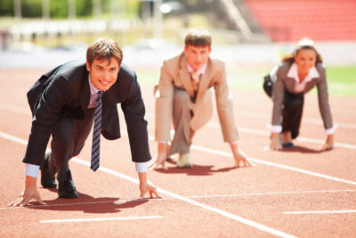 runners in business suits