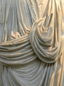 Intricate carving on marble depicting cloth on the sculpture