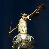 cropped-cropped-old-bailey-scales-of-justice-at-night.jpg