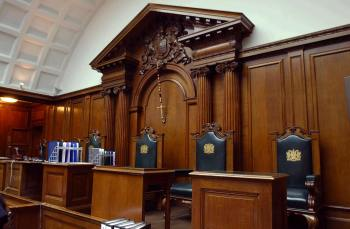 INSIDE A COURT ROOM