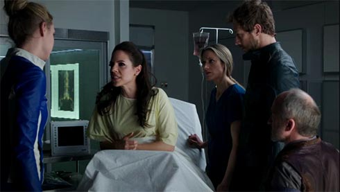 Bo in the hospital with her friends all around.