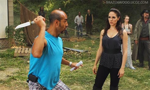 Anna Silk getting coached on knife techniques during the filming of Lost Girl