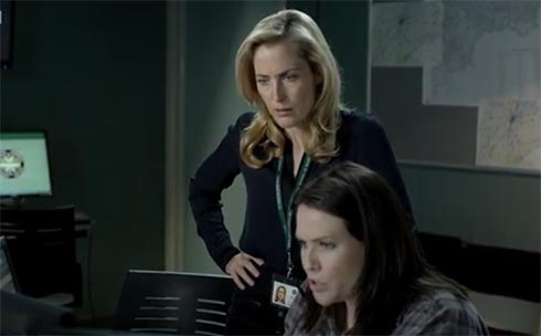 Gillian Anderson watching monitors with Control