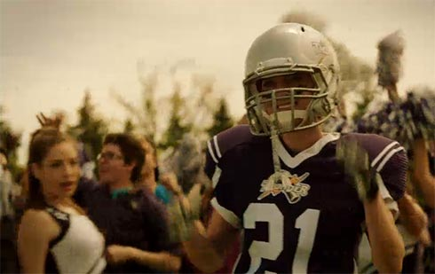 Tamsin in a football uniform