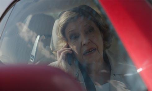 Celia in the car.
