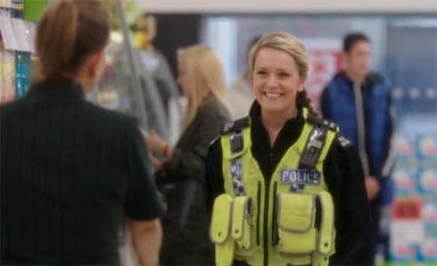 Cheryl in her cop's uniform.