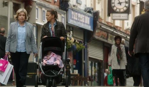 Celia and Gillian walk down the street.