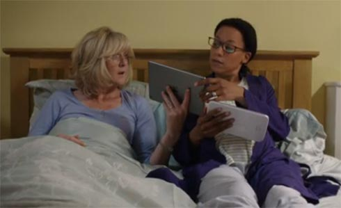 Caroline shows Kate something on her iPad