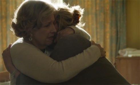 Celia holds Caroline