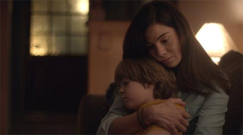 Maggie Swann hugs her son Paul in Fort Bliss