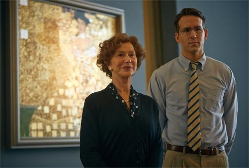 Helen Mirren and Ryan Reynolds in front of the painting.