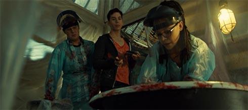 Cosima, Scott and Felix work on Seth's corpse.