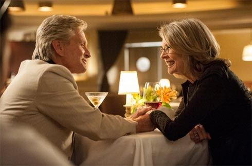 "MIchael Douglas and Diane Keaton at a restaurant table in ""And So It Goes"""