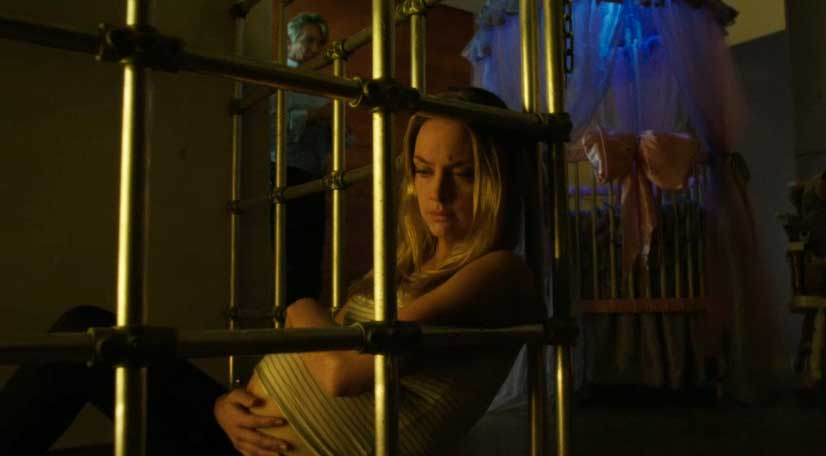 Tamsin in a cage