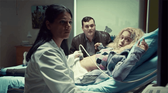 Kristian Bruun and Tatiana Maslany as Helena watch an ultrasound in Orphan Black