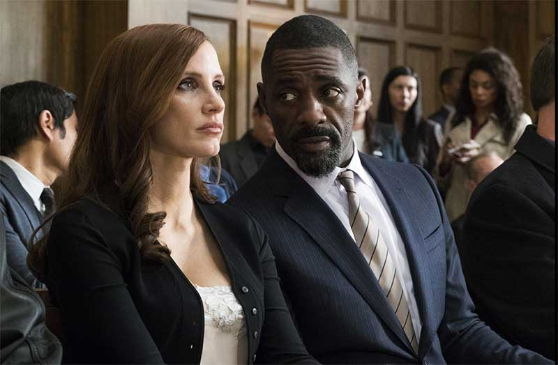 Idris Elba and Jessica Chastain in Molly's Game