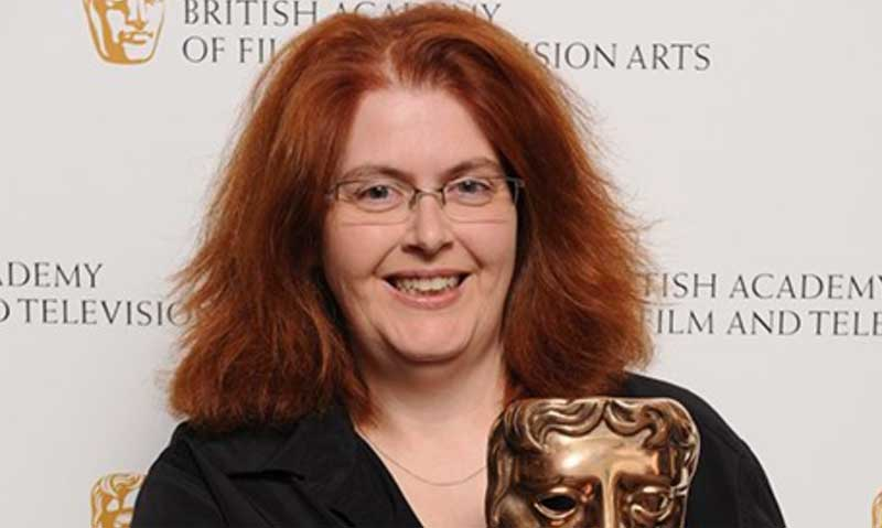 Sally Wainwright holding a BAFTA