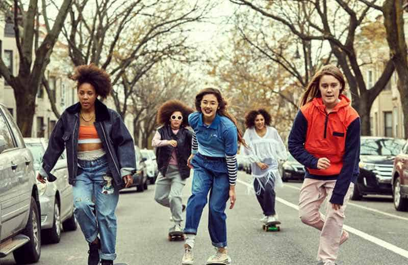 Rachelle Vinberg and her friends skating down the street in Skate Kitchen