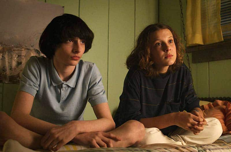 Millie Bobby Brown, and Finn Wolfhard in Stranger Things