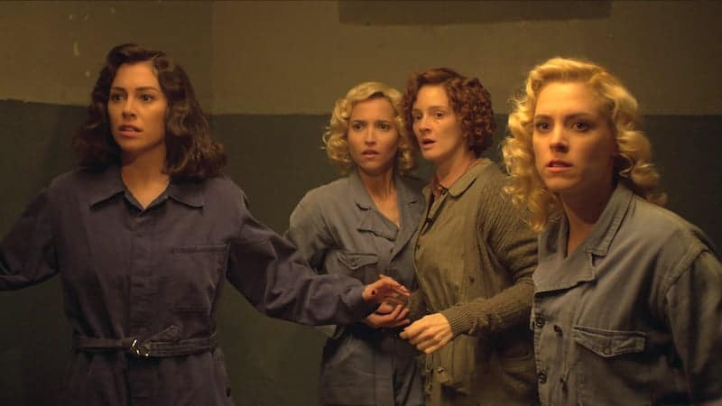 The chicas dress in prison garb
