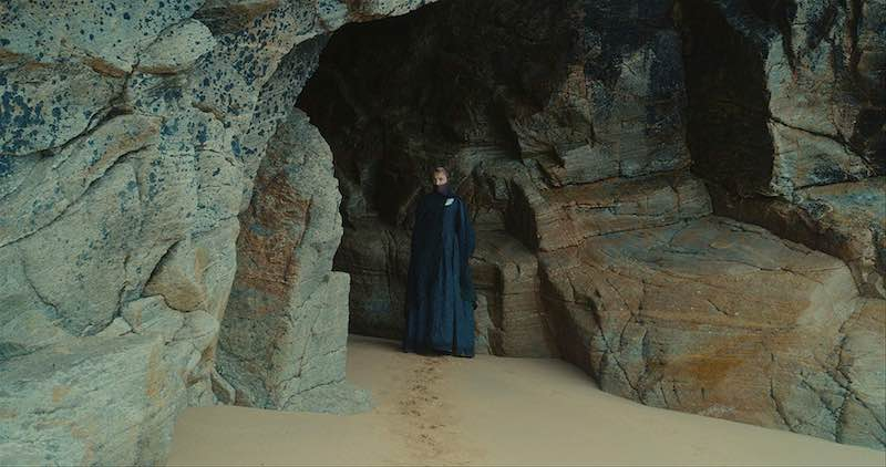 Héloïse waits in a rocky cave in Portrait of a Lady on Fire