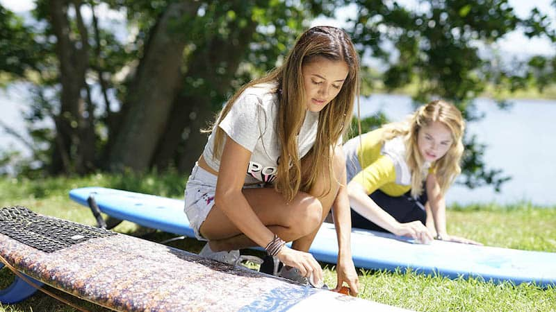 Debby Ryan and Naomi Sequeira in Rip Tide