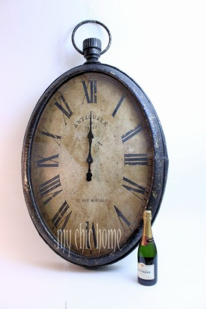 Large Oval Metal Wall Clock