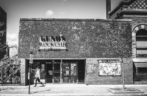 a B&W photo of a night club from the street