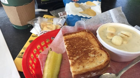 A toasted sandwich and clam chowder