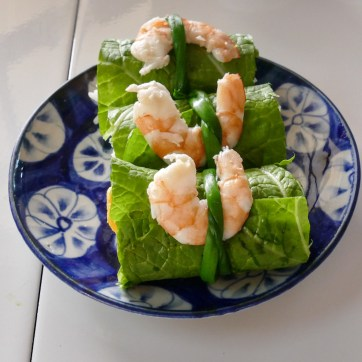 Egg and Pork wrapped up in a mustard leave with prawns.