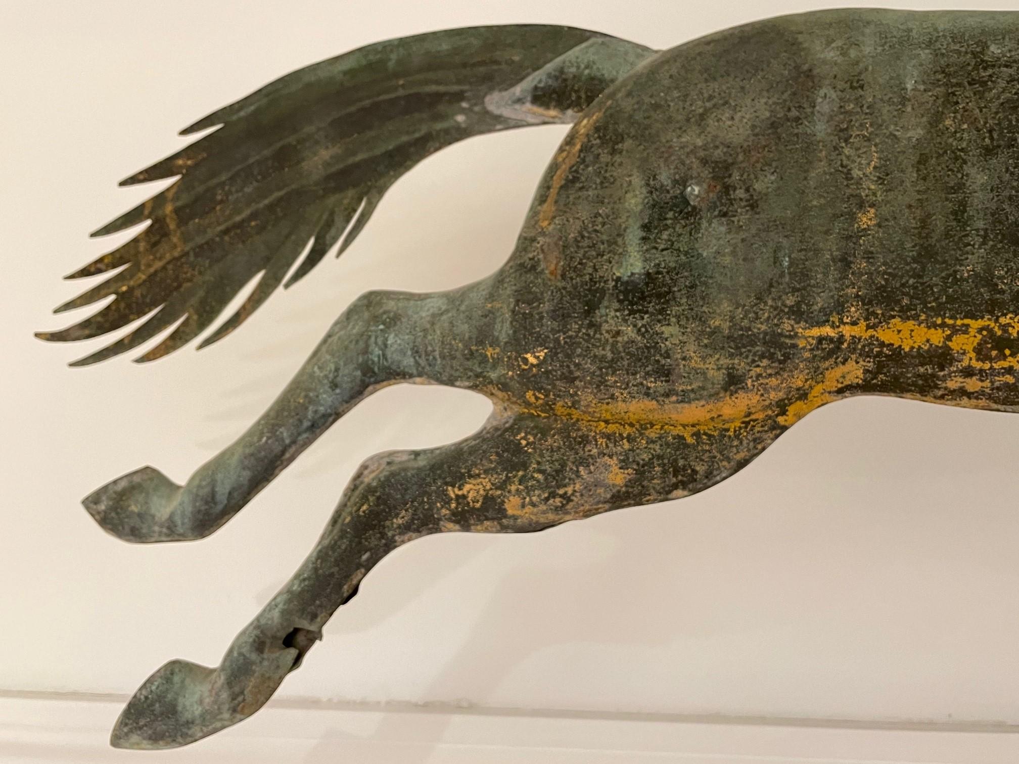 antique horse hoop weathervane rel=