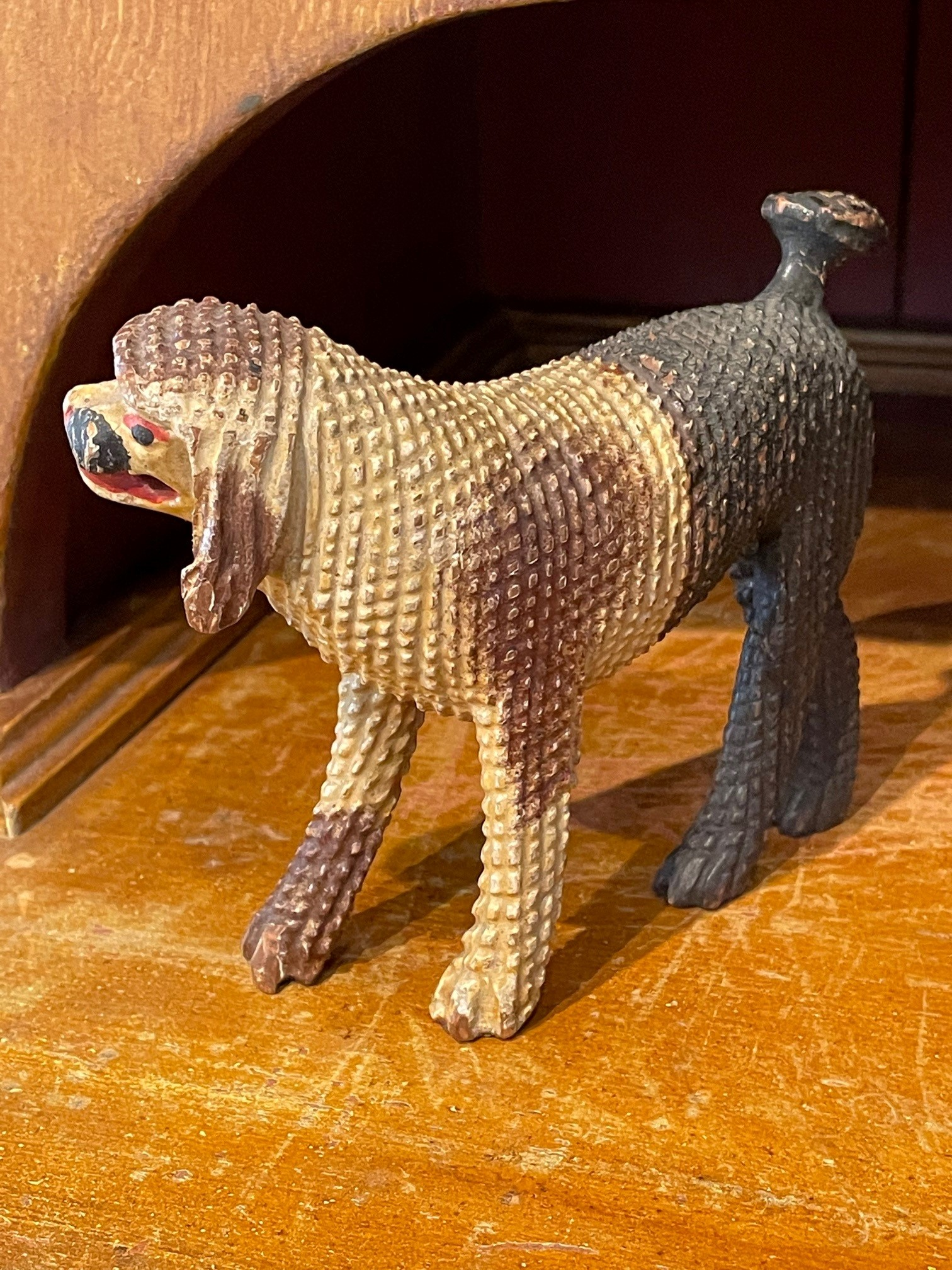 folk art carving of a poodle rel=