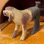 folk art carving of a poodle